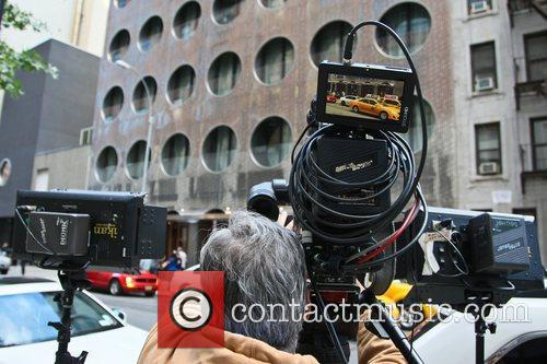 Media crews assemble outside the Dream Hotel in...