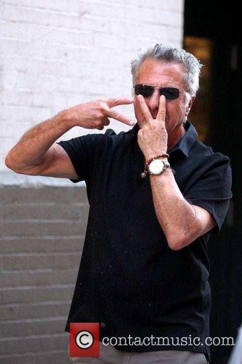 Dustin Hoffman  makes funny hand gestures as...