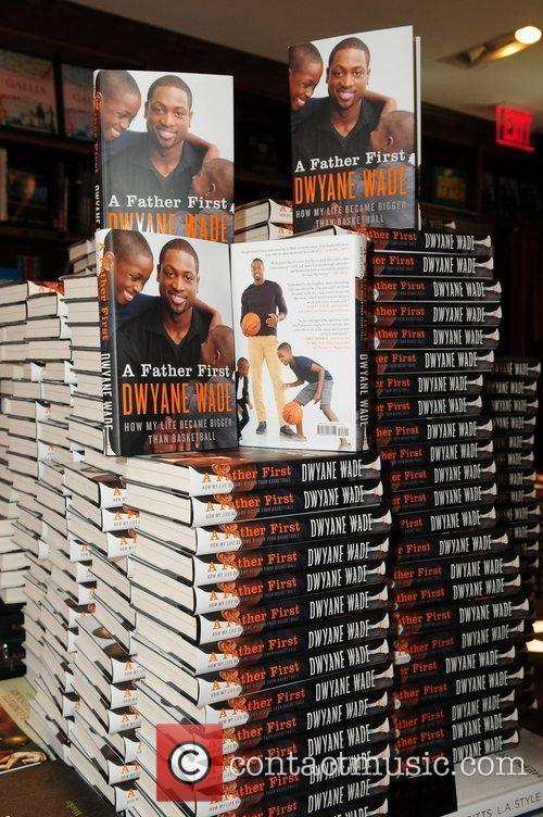 Dwyane Wade greets fans and signs copies of...