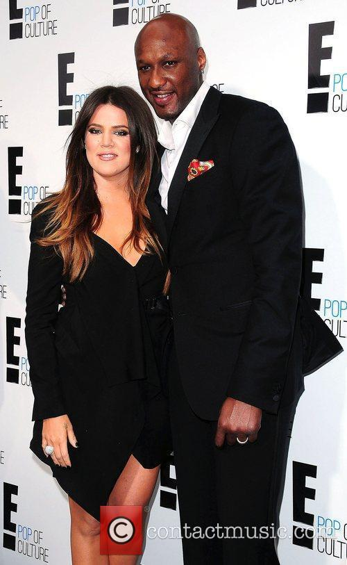 Khloe Kardashian and Lamar Odom,  at E!...