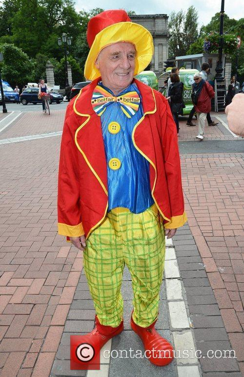 RTE soccer pundit Eamon Dunphy dressed as a...
