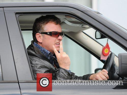 Shane Richie giving the 'V' sign to photographers...