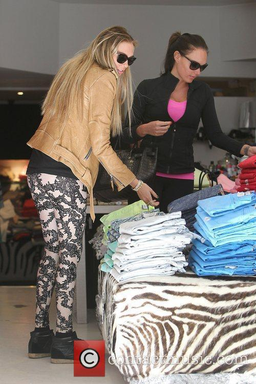 Petra Ecclestone and Tamara Ecclestone shopping on the...