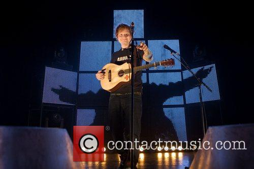 Ed Sheeran playing a headline gig at the...