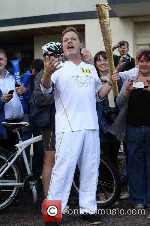 Eddie Izzard carries the Olympic torch in Bexhill-On-Sea