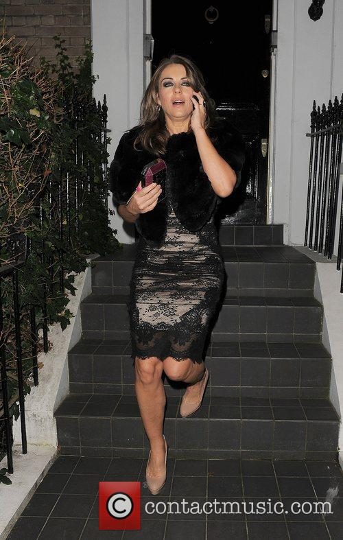 Elizabeth Hurley leaving her house to attend a...