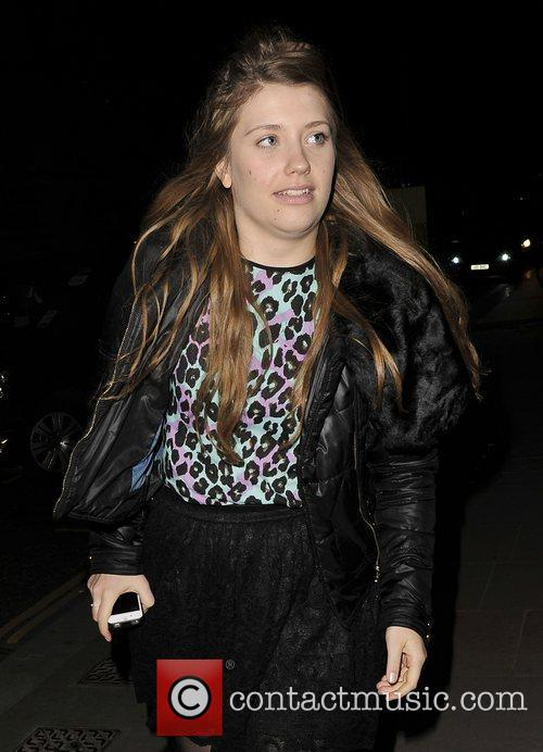 X Factor star, Ella Henderson arrives back at...