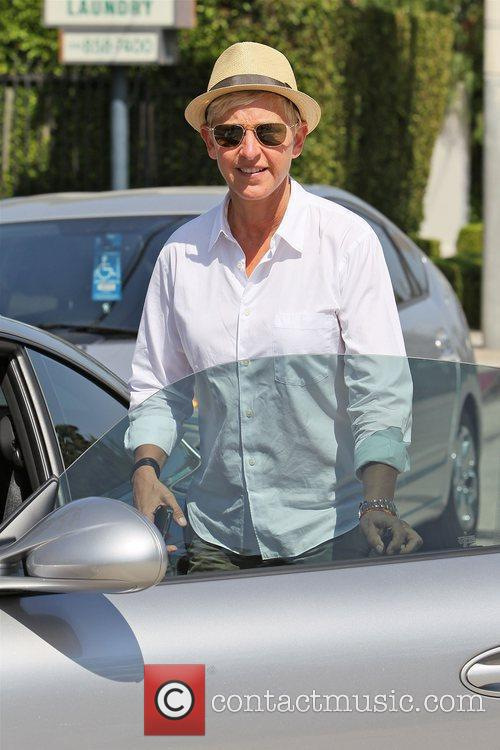 Ellen DeGeneres out and about wearing a straw...