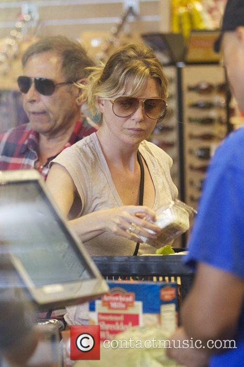 Ellen Pompeo paying for groceries at Whole Foods...