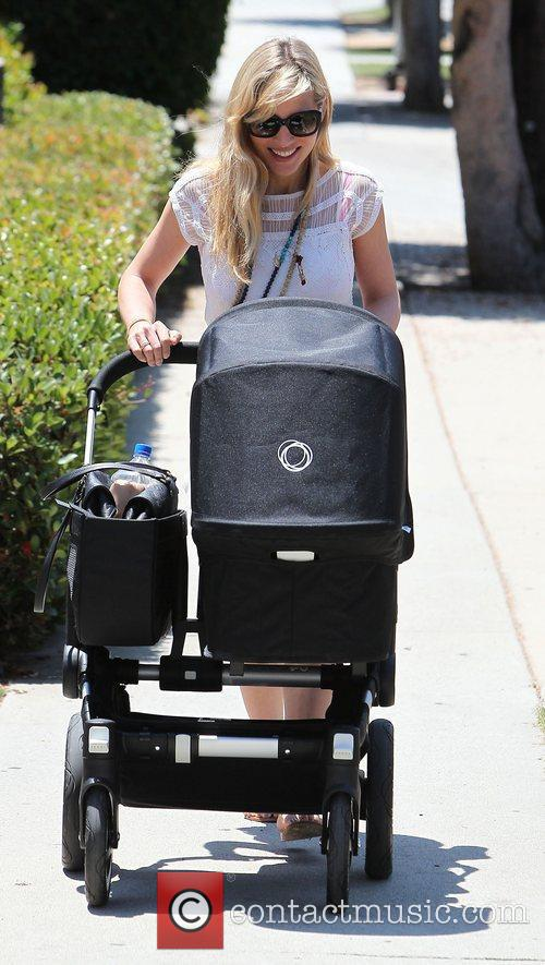 Elsa Pataky out and about pushing daughter India...