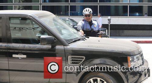 Emma Roberts Range Rover gets a parking ticket...