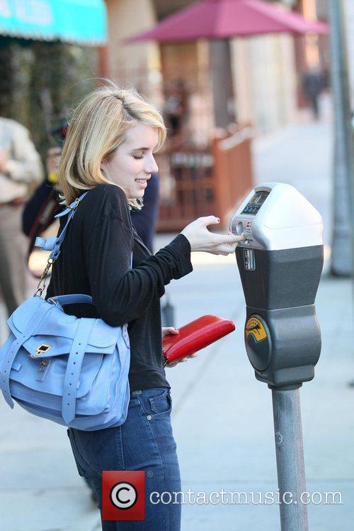 emma roberts pays her card into a 3675968
