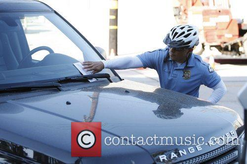 A traffic officer placed a parking ticket on...