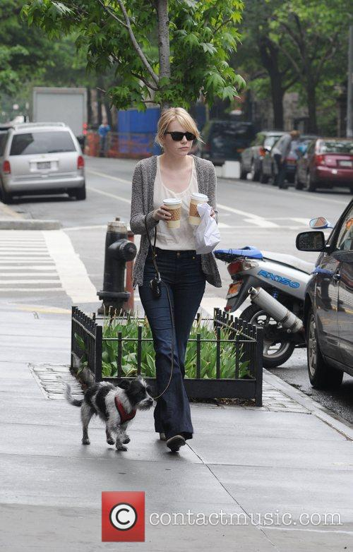 Stops to grab coffee whilst out walking her...