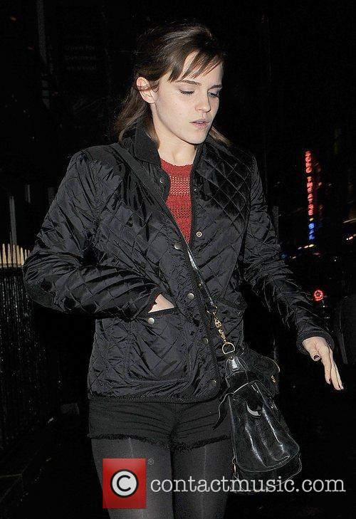 Emma Watson appears rather camera-shy as she walks...