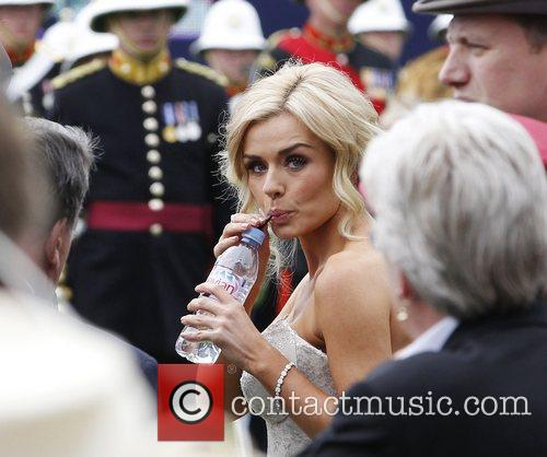 Katherine Jenkins drinks some water before her performance...