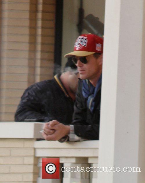 Eric Dane  smoking a cigarette while leaving...