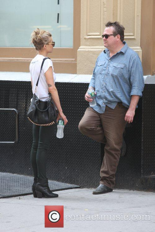 Eric stonestreet seen with a female companion in for Eric stonestreet house