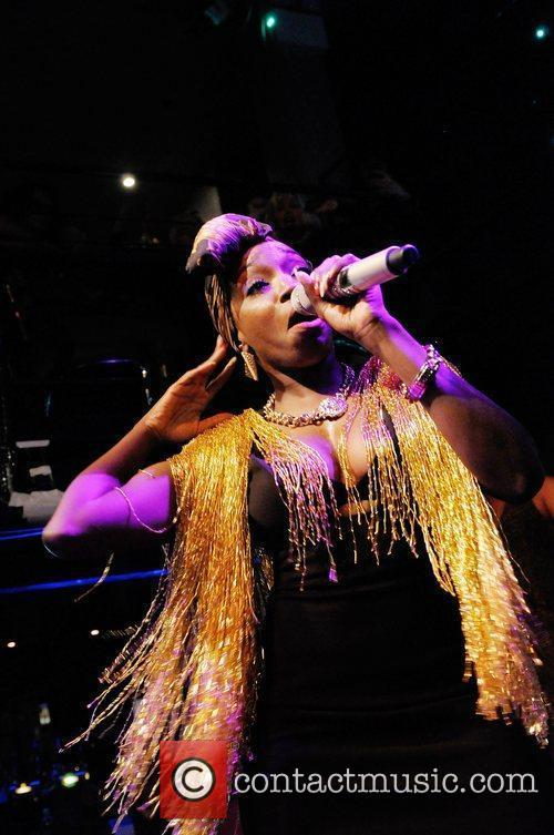 Performs on stage at The Jazz Cafe.