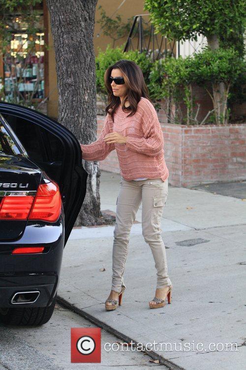 Eva Longoria returns to her car after visiting...