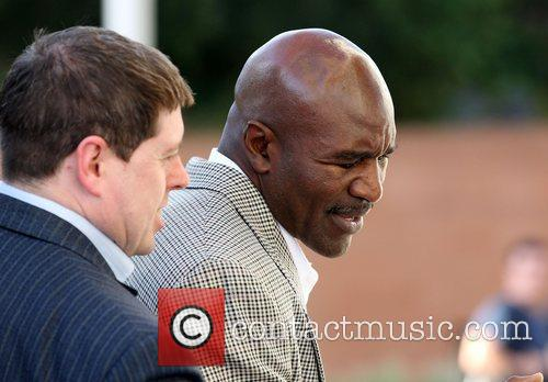Evander Holyfield  leaves the Hilton hotel in...