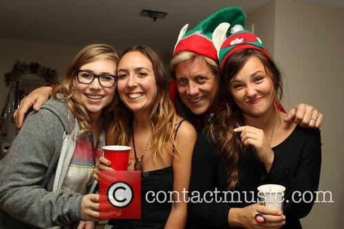 The Evigan Family Holiday party held at a...