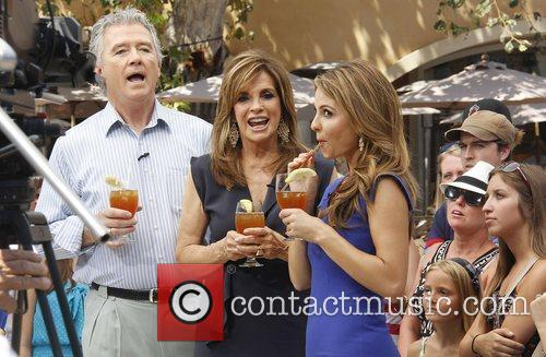 Patrick Duffy and Linda Gray with Extra host...