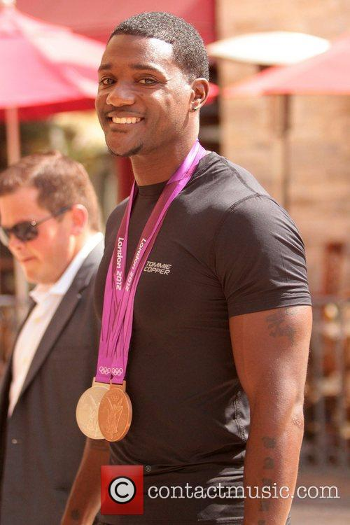 Justin Gatlin Celebrities at The Grove for the...