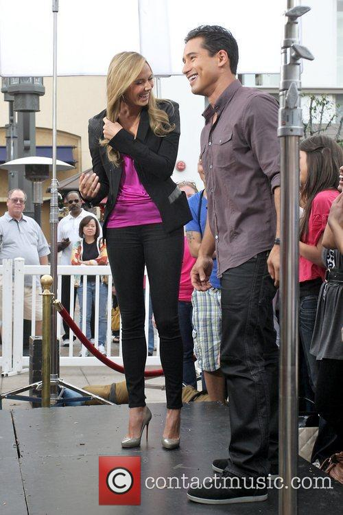 Stacy Keibler and Mario Lopez filming an appearance...