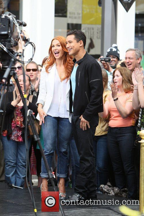 Poppy Montgomery and Mario Lopez 29