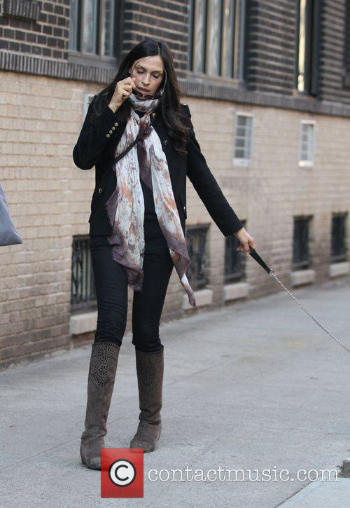 Walking her dog in Soho