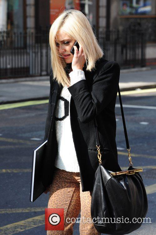 Seen on her cell phone leaving Radio 1