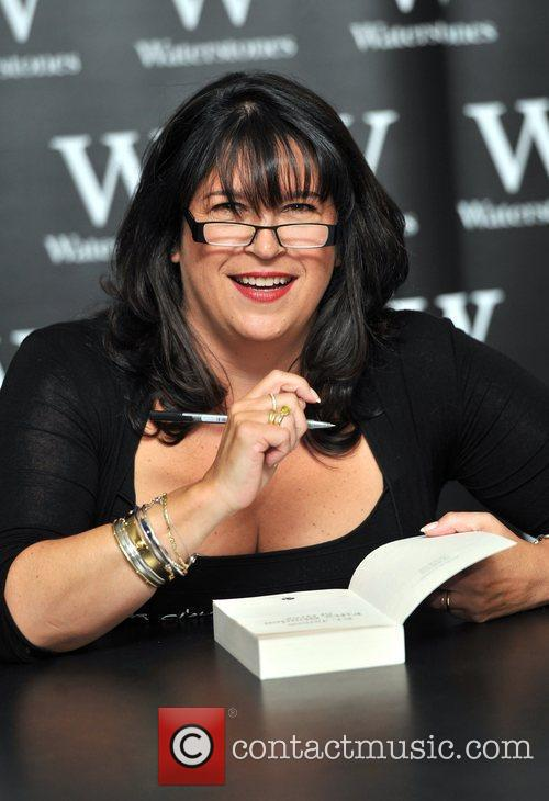 Signs copies of her book 'Fifty Shades of...