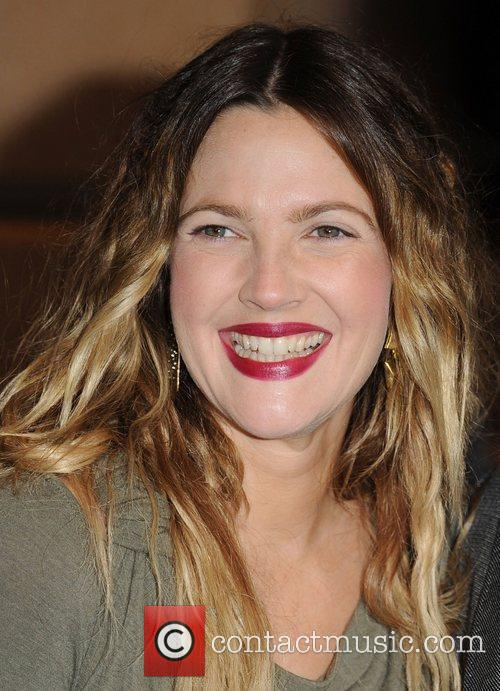 *file photo* * BARRYMORE ENGAGED DREW BARRYMORE is...