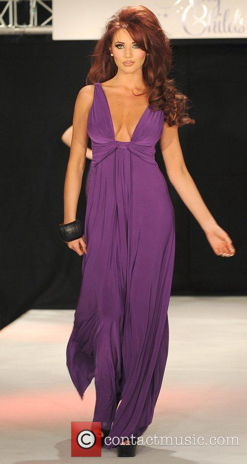 Amy Childs on the catwalk at the launch...
