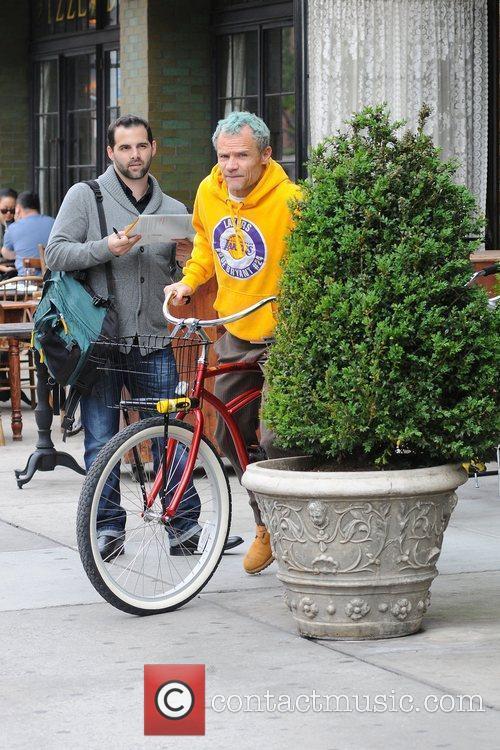 Flea aka Michael Balzary  riding his bicycle...