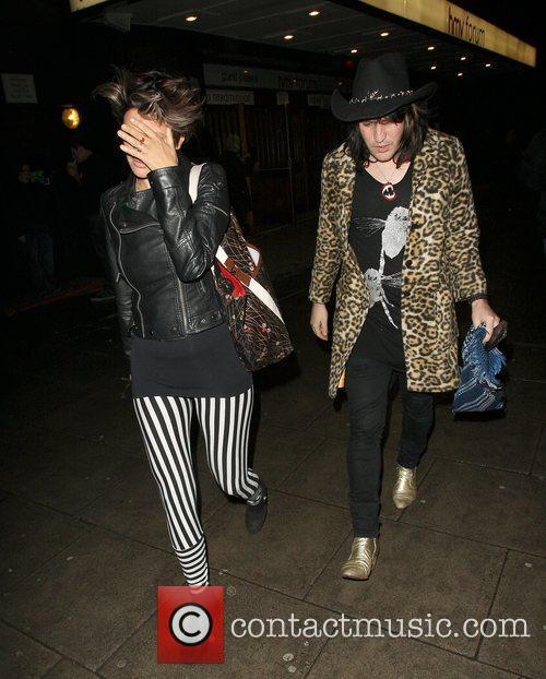 Noel Fielding with a female companion leaving HMV...