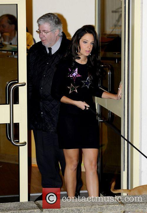 tulisa contostavlos with a dog on a 5932720