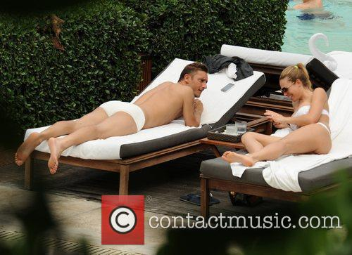 Francesco Totti and wife Ilary Blasi relax by...