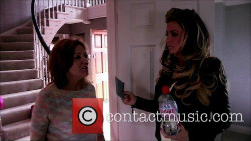 Amy Price hands her daughter Katie Price a...