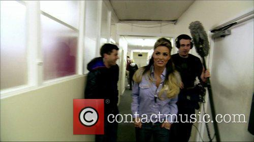 Katie Price makes her way through a studio...