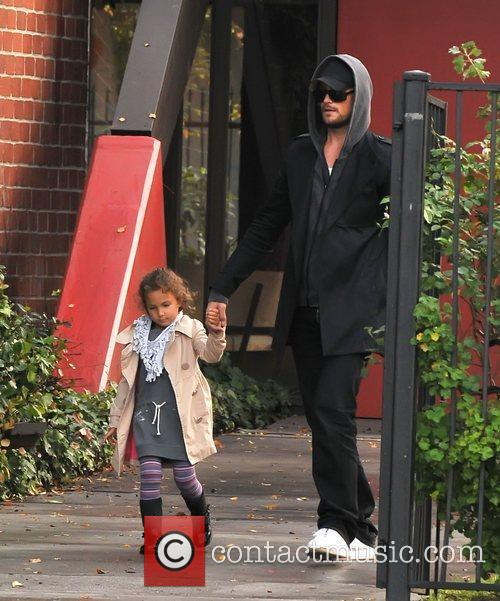 Gabriel Aubry collects his daughter, Nahla from school....