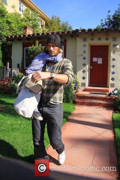 Gabriel Aubry  picks up his daughter Nahla...