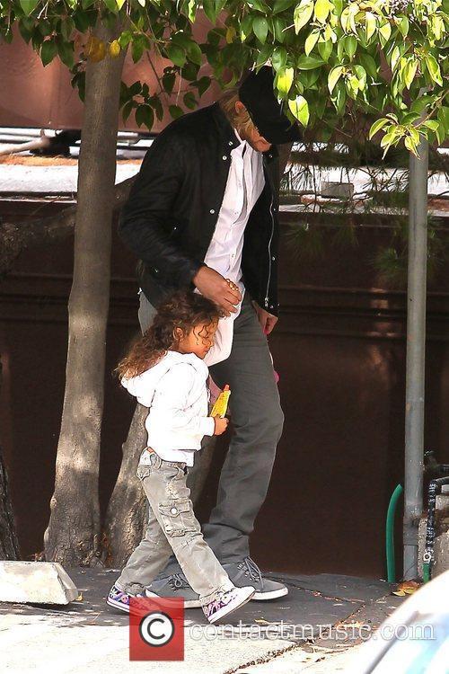 Gabriel Aubry picking up his daughter Nahla Aubry...