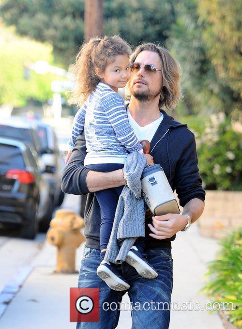 Gabriel Aubry picks his daughter Nahla Aubry up...