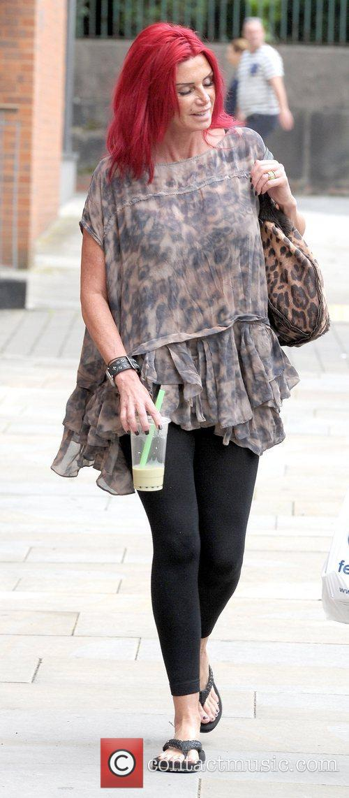 Gemma Numan holding a cold beverage as she...