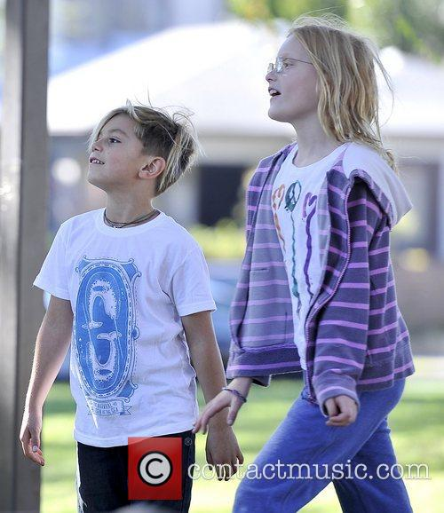 Kingston Rossdale playing with a little girl he...