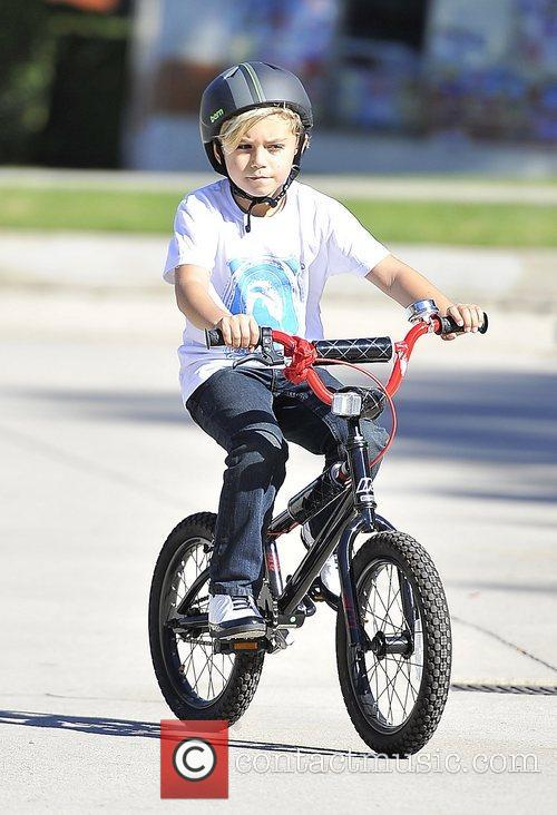 Kingston Rossdale riding his bike at a park...