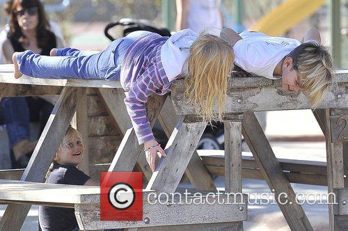 Zuma Rossdale, under the table and Kingston Rossdale...