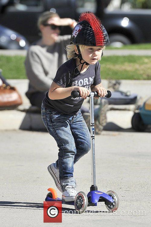 Zuma Rossdale wearing a 'mohawk' helmet while riding...